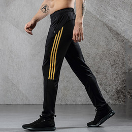 Argentina LYNSKEY Pantalones deportivos transpirables Pantalones de running para hombre con bolsillo de cremallera Pantalones de entrenamiento Pantalones deportivos Pantalones de fitness para hombres cheap joggings pants Suministro