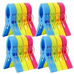 Pinzas de ropa online-4 unids / set Clips de color creativo Toalla de playa Abrazadera para evitar la abrazadera de viento Pinzas para la ropa Estantes de secado Clip de retención