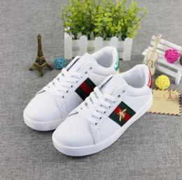 Niños de lona blanca online-Calzado infantil Pring y Otoño Nuevos zapatos de lona para niños medianos y grandes Niños Calzoncillos blancos Niñas Abejas pequeñas Placas de ocio 35-44cm