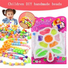I giocattoli della novità della ragazza DIY che borda fatto a mano creativo, materiale di fabbricazione a catena della mano, perle di plastica hanno mescolato all'ingrosso, monili dei braccialetti di fascini da