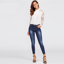 Jeans ebene online-Frühling dünne Perle Perlen verblasst Wash Jeans blau Mitte Taille Reißverschluss fliegen Plain Denim Jeans Frauen Casual Hosen heißer Verkauf