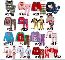 Argentina 2-7T Niños pijama de Navidad conjunto de manga larga Pullover camiseta + Pantalones de Navidad Elk Deer Snowman Super hombre de Santa Claus Cartoon Print camisón caliente Suministro