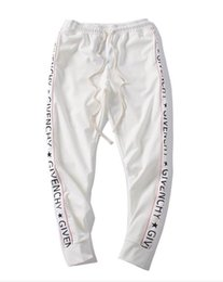 cadena de diseño Logo men women Joggers Casual Harem Sweatpants sport pants Moda impresión masculina Motion Trousers desde fabricantes