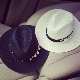 Wholesale foldable hats women - Pearl Jewelry straw hats for women Cowboy Hats Party Beach Sun Hat Foldable Brimmed Straw Caps 2colors Ladies Hollow Straw Beach Cap