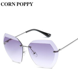 c035690f7 New style ocean piece sunglasses European and American fashion glasses  rimless metal sunshade Optik Glasses For Woman