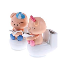 Wholesale Plastic Toy Toilets - 1pcs Blue Cute Solar Toys Solar Powered Bobble Head Pig Sitting On Toilet Home Car Ornament Kids Toy