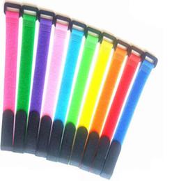 Argentina 50 unids / lote Reutilizables Bridas de nylon para cables Gancho y bucle Atadura de cables con ojales Agujero Organizador de cables Gancho de bucle cintas adhesivas 2 X 20 CM Suministro