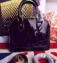 Wholesale Vintage Saddle Bags - Dropshipping Dropshipping ALMA BB shell bag women patent leather flower Embossed shoulder bags with lock crossbody bag handbags.