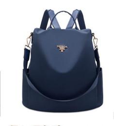 silber metallic farbe schultertasche Rabatt weibliche rucksäcke designer 2019 mode dame Oxford leinwand reisetasche frauen charms handtasche schultasche
