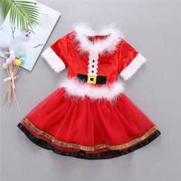 2019 gasa de burbujas Collar muchachas de la Navidad vestido de Santa Claus Conjunto de piel Top de manga corta y Bubble gasa falda 2pcs de los cabritos ropa de Navidad equipo del bebé A101101 gasa de burbujas baratos