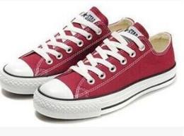 Clássico vestir-se on-line-Top Clássico conve1s2e venda Quente Unisex LOW-Top Adulto das Mulheres dos homens Sapatas de Lona Vestido Laced Up Sapatos Casuais Sapatilha sapatos
