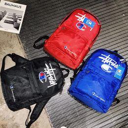 silber metallic farbe schultertasche Rabatt Mode Brief Gedruckt Roten Rucksack Designer Marke Männer Sporttasche Hohe Kapazität Schüler Schultaschen für Unisex