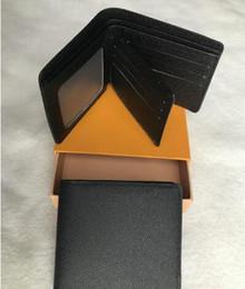 Bolsas de pasaporte online-Organizador de bolsillo de excelente calidad NM damier rojo hombres y mujeres Carteras de pasaporte de cuero real tarjetero N63144 monedero id billetera bolsos plegables