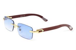 Semelle occhiali en Ligne-mens lunettes de luxe lunettes de corne de buffle blanc lunettes pour femmes hommes verres clairs bois jambes en or doré Occhiali da sole di marca