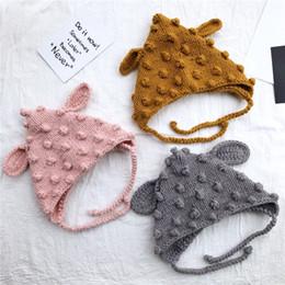 Coniglio crochet per bambini online-Coniglietto Orecchie a maglia cappello dei bambini Crochet Beanie cappelli per bambini caldi dei paraorecchie Cap Festa di Natale Caps TTA1906