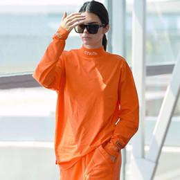 camisa naranja de manga larga para mujer. Rebajas HERON PRESTON Camiseta de cuello alto Estilo bordado Camisa de algodón de manga larga Hombres Mujeres Hip Hop Streetwear Tees Naranja Negro Blanco YCI0207