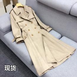 Argentina Primavera y otoño coreano OL doble botonadura caqui delgado tipo de falda de cintura larga gabardina larga hasta la rodilla abrigo para mujeres Suministro