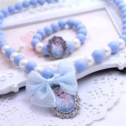 Chicas congeladas accesorios online-Joyería para niños Accesorios para muñecas para niños Princesa congelada Collar con pulsera Set 2 pcs / lote Candy Beads Necklace Girls Gifts