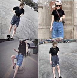 Дизайнерские модные мужские женские прямые облегающие байкерские джинсы Брюки проблемные зауженные рваные разрушенные джинсовые джинсы Промытые брюки хип-хоп черные supplier slim black trousers womens от Поставщики черные брючные женские брюки