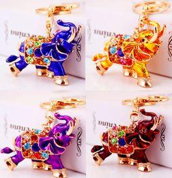 3D Crystal Rhinestone lindo elefante llavero de metal llavero llaveros del coche monedero encantos bolso colgante de metal animal colgante llavero desde fabricantes