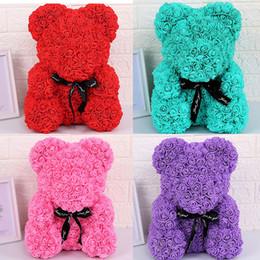 encanto del bastón de caramelo de navidad Rebajas Día de San Valentín 2020 Navidad para 25 cm / 10 pulgadas de oso de juguete de regalo Rose señoras de 17 colores que abraza el oso Flores arco M1058