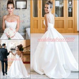 e8b3083408bd 2019 vestiti dalla chiesa a basso costo Elegante bianco senza spalline Plus  Size Abiti da sposa
