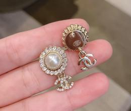 il gancio all'ingrosso dei monili di s Sconti gioielli di moda elegante perla orecchini chiodo stile centinaio di corrispondenza