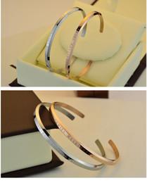 2019 diseñador de brazalete de oro Pulseras de diseño DW Brazalete de plata y oro rosa Pulsera de acero inoxidable 100% Pulsera de mujer y hombre Regalo de amistad Pulsera Caja al por menor rebajas diseñador de brazalete de oro