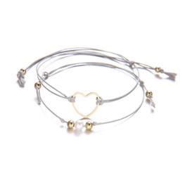 Elegantes brazaletes de perlas online-2 Unids / set Charm Cuerda Trenzada Perla Corazón Brazalete Pulsera Elegante Corazones Huecos de Múltiples capas Armadura Cuerdas Tobilleras Pulseras Joyería de las mujeres