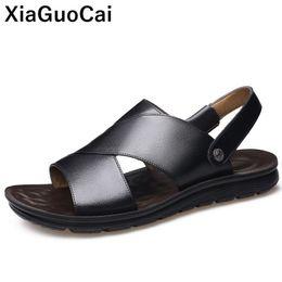Zapatos planos usados online-2019 Summer Men Beach Shoes Sandalias de cuero genuino para hombre Zapatillas Dos usos Antideslizantes Ocio Diapositivas planas Conciso de alta calidad