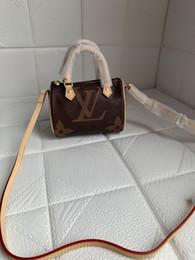 2019 sacos de balde mini SPEEDY ombro M61252 Mini bonito bolsa de ombro de couro sacos de cruz 16 cm feminino NANO balde flor marrom mini almofada SACO DO CLIQUE desconto sacos de balde mini