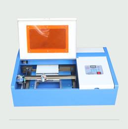 Argentina 3020 sobremesa de 40 vatios 300 x 200 mm Mini máquina de corte por grabado láser co2 con plataforma arriba y abajo 320 Suministro