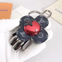 Роскошный милый цветок дизайнер брелок из нержавеющей стали робот кожаный аксессуар автомобиль брелки для подарков с коробкой от