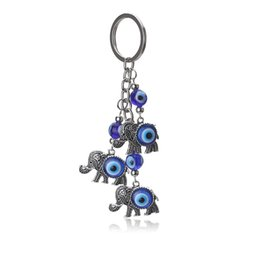 Anillo de mal de ojo azul online-Eye Evil New Fashion Evil Eye Elephant Keychain Trendy Metal Blue Evil Eye Animal Keychain Colgante para Mujer Hombre Llavero