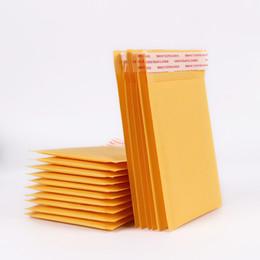 Envelopes de papel kraft on-line-5 Pçs / lote Atacado 110 * 130mm Bolha Envelopes Sacos Mailers Acolchoado Envelope de Envio de Saco de Embalagem de Papel Kraft Bolha Suprimentos frágeis
