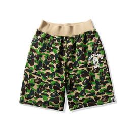 fbcfd4176 Distribuidores de descuento Mujeres Playa Verde Pantalones Cortos ...