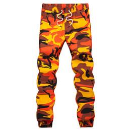 Pantalón de camuflaje naranja Ins Pantalón de hombre Hip Hop Tejido Pantalones casuales Pantalón militar táctico Bolsillos de algodón 2019 Pantalones deportivos desde fabricantes