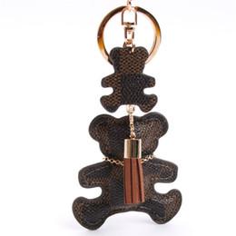 Cuero de la PU del oso llavero borla llavero bolsa de coche llavero para las mujeres accesorios de joyería de regalo desde fabricantes