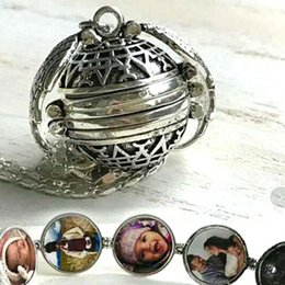 Magic Photo Pendant Memory Floating Locket Collar Plateado Alas de Ángel Caja de destello Caja de álbum de moda Collares 4 colores ZZA346 desde fabricantes