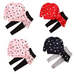 Conjunto de falda sudadera online-Día de San Valentín Ropa Niños sistemas de la muchacha del amor del corazón Impreso con capucha Top + Skirt Amor pantalones 2pcs / set Trajes Boutique Ropa Niños M1013