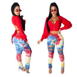 Roupas para senhoras magras on-line-Mulheres Buracos Impresso Designer Jeans Skinny Sexy Floral Distressed Calças Lápis Das Senhoras Streetwear Colorido Roupas Femininas