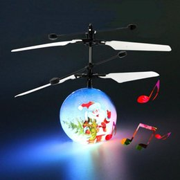 rc fly ball Promo Codes - Santa Claus RC Induction Aircraft Music LED Flashing Flying Ball Toy LED Light Remote Control Drone HelicopterToy Kids Christmas Gifts