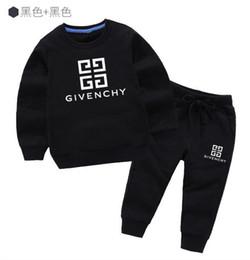 Mejor venta de algodón de los niños impresos camisa moda suelta traje deportivo tendencia sudadera con capucha calidad bebé ropa traje desde fabricantes