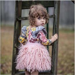 Faldas tutu con volantes de chicas online-Niñas Ins borlas de piel sintética faldas de tutú rosa volantes niño bebé ropa de moda otoño primavera