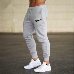 Algodão casual calças para homens on-line-2019 novo logotipo dos homens de fitness calças de algodão dos homens esportes e calças de fitness calças esportivas casuais jogging calças apertadas