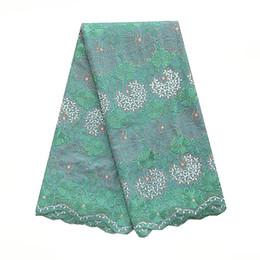 Últimas telas de encaje nigeriano Algodón tejido de encaje bordado suizo verde azulado verde melocotón seco África encaje tela de cordones de alta calidad desde fabricantes