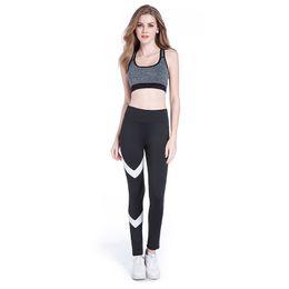 2019 pantaloni stretti di esercitazione Pantaloni da yoga Leggings a compressione da donna Collant da palestra per esercizi Leggings da corsa per fitness Pantaloni da ginnastica slim a strisce Pantaloni push-up sui fianchi pantaloni stretti di esercitazione economici