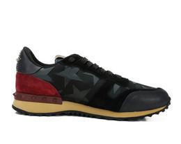 Nuevo Top Fashion Stud Zapatillas de deporte de camuflaje Calzado Mujeres Pisos Diseñador de lujo Rockrunner Zapatillas de deporte Hombres Zapatos casuales desde fabricantes