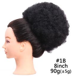Argentina 100g Extensiones de cola de caballo grandes del pelo del Afro del pelo del pelo sintético natural Clip rizado del buñuelo del buñuelo en la peluca del bollo para las mujeres negras Suministro