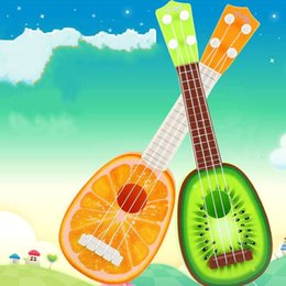2019 образовательный английский планшет Лучшие продажи детская мини укулеле фрукты гитара головоломки пластиковые музыка инструмент обучения также может быть развлекали раннего детства игрушки